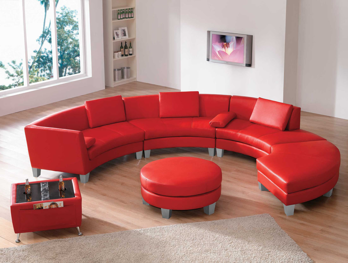 Contemporary-Living-Room-Sets-with-U-Shaped-Red-Sofa-Living-Room-near-Round-Shaped-Red-Leather-Coffee-Table-Ottoman-plus-Wooden-Flooring-also-White-Wall-Paint-and-Glass-Windows-Set