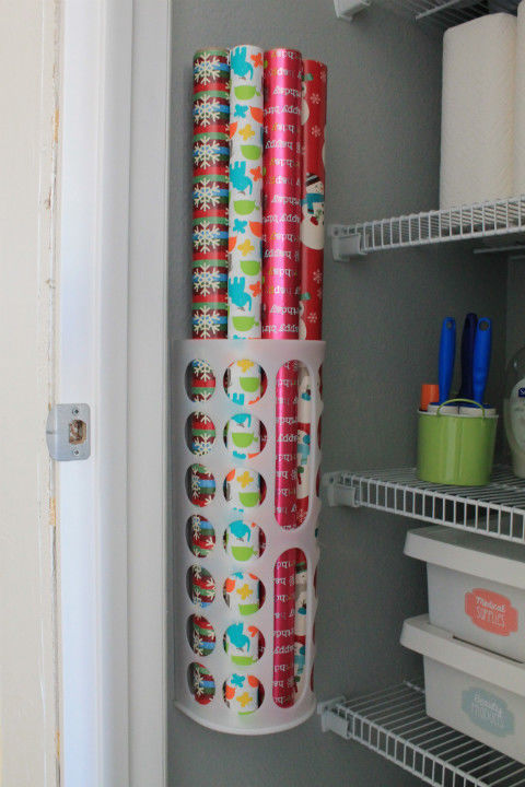 gallery-1447188585-utility-closet-wrapping-paper-storage