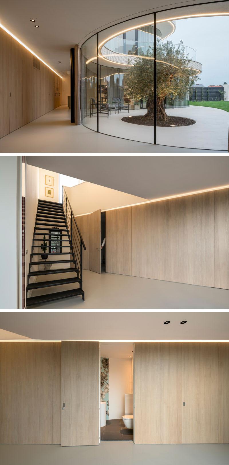 curved-windows-hidden-bathroom-stairs-130317-1008-03